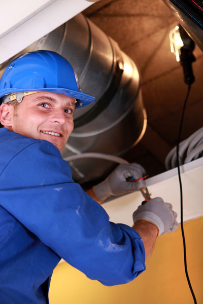 man repairing heating system